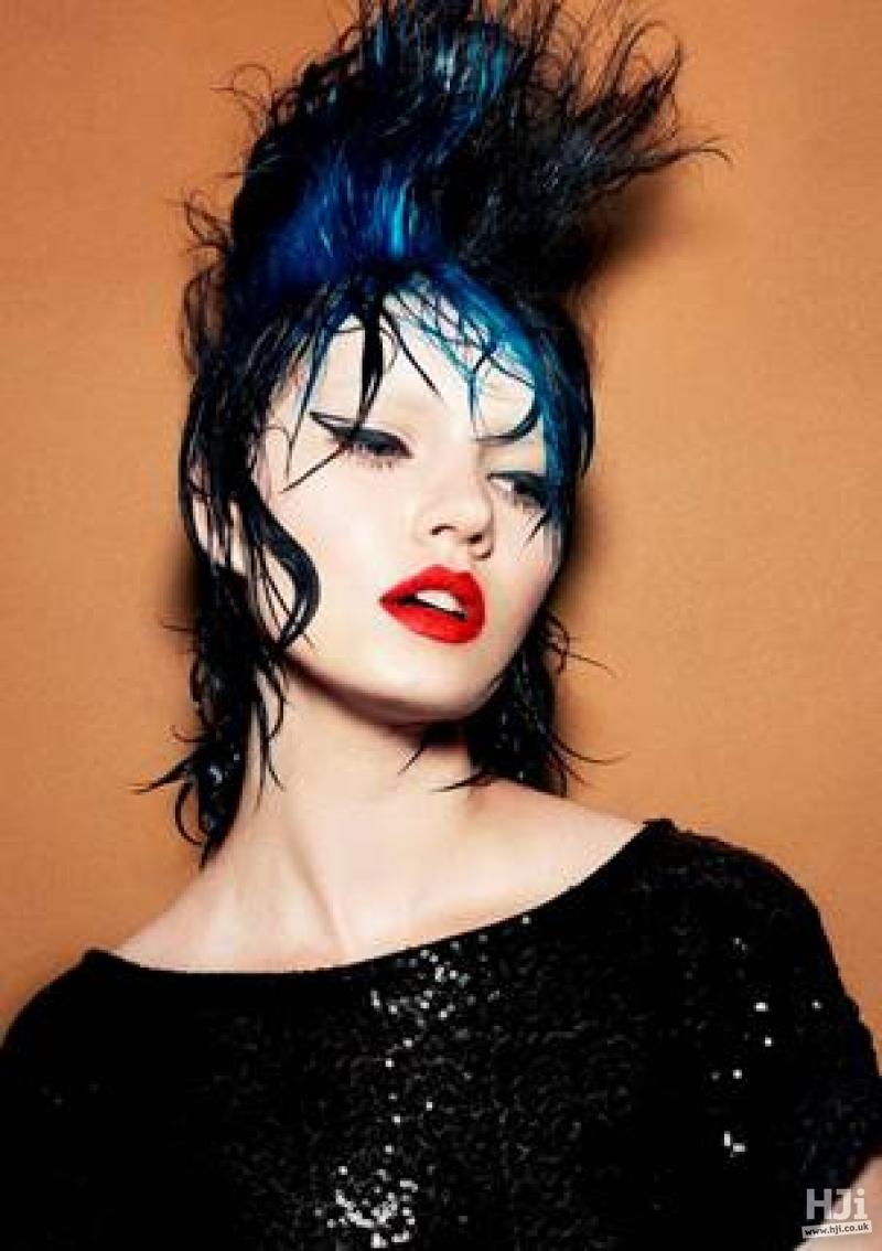 Messy wet look black and blue avant garde updo