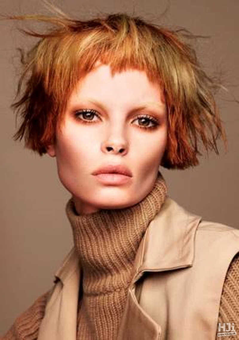 Short choppy fringe with natural texture and auburn shades