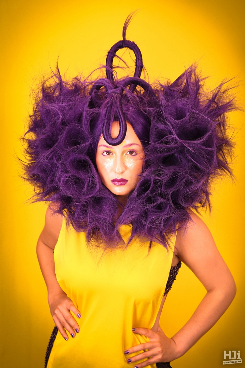 Blown out purple hair with creative shaping