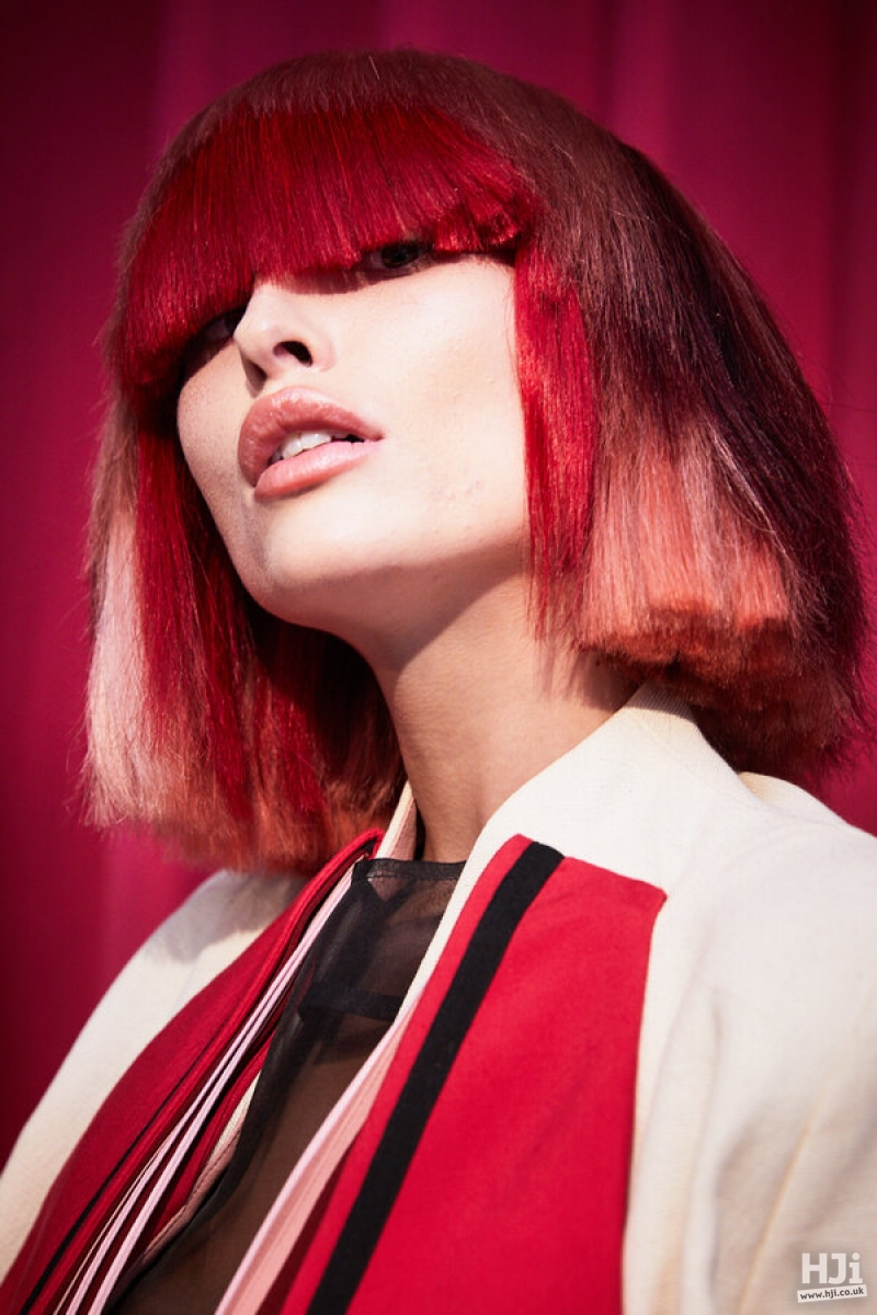 Red creative colour bob with eyelash-skimming fringe