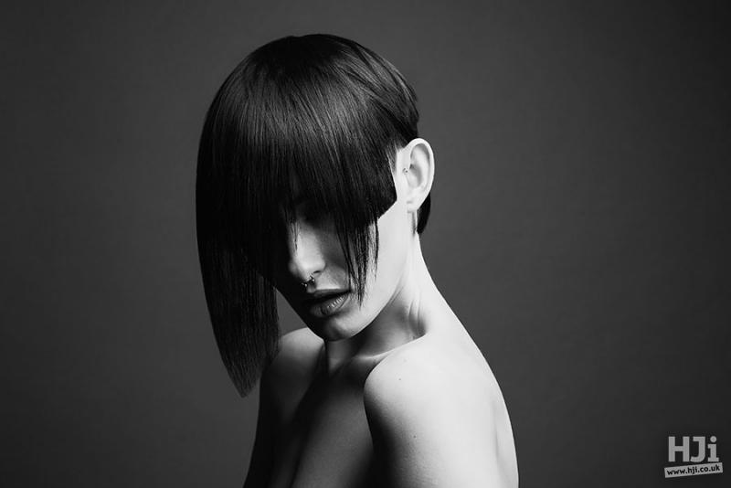 Short sleek hairstyle with asymmetric fringe