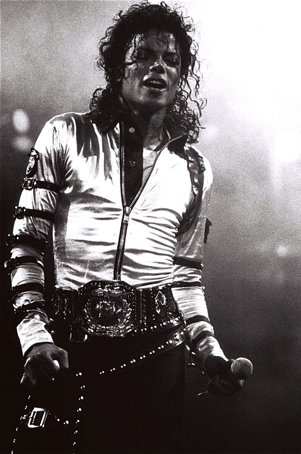 A mass of tumbling, shoulder-length curls make an impact on stage in 1988