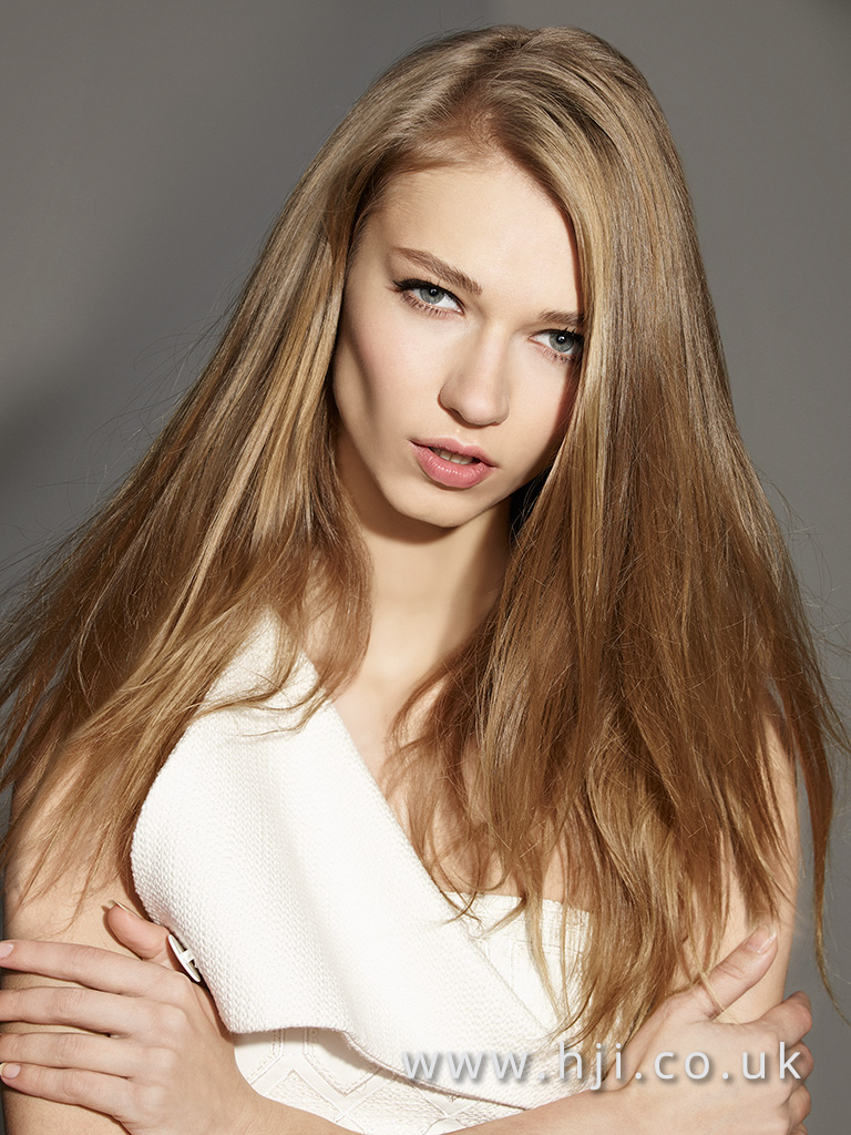 2016 Mid blonde smooth long length style with sleek shiny finish and piecy texture