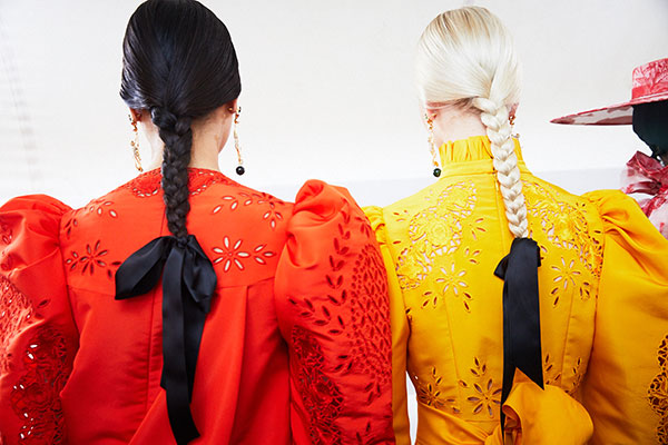The trending updo hairstyle from SS20 Fashion Week is full of platts, braids and ponytails.