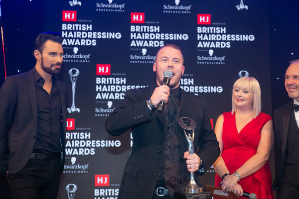 British Hairdresser of the Year Robert Eaton giving his speech at BHA19