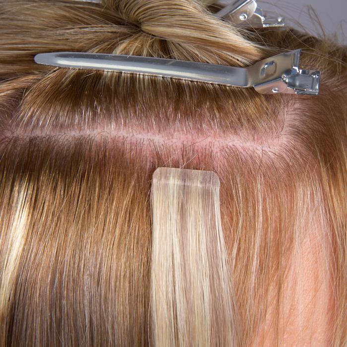 final step applying hair extensions